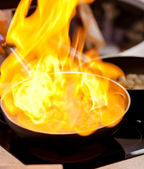 Pot with fire — Stock Photo