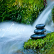 Pebble stones over waterfall — Foto de stock #8829843
