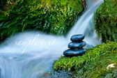 Pebble stones over waterfall — Stock Photo