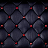 Red genuine leather upholstery — Stock Photo