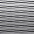 Stock Photo: Perforated plastic background