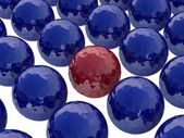 Red ball among dark blue balls — Stock Photo