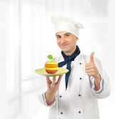 A male chef with mixed fruits — Stock Photo