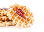 Waffles with jam isolated on white — Stock Photo
