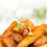 Fried potato wedges closeup — Stock Photo