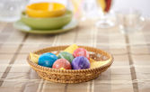 Colorful painted easter eggs in a basket — Stock Photo