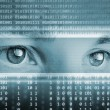 Technology background with eyes on computer display — Stock Photo