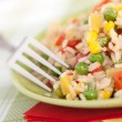Bowl of rice with peas and red peppers — Stock Photo