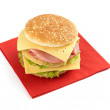Sandwich with lettuce, ham, cheese and tomato — Stock Photo