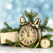 Stock Photo: Christmas concept. Old golden clock and fir-tree
