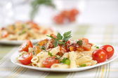 Italian pasta with sauce and parmesan cheese — Stock Photo