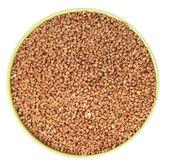 Kabın içinde ham buğday — Stok fotoğraf
