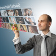 Businessman pressing social buttons on a virtual background — Stock Photo