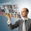 Businessman pressing social buttons on a virtual background — Stok fotoğraf