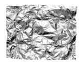 Abstract crumpled silver aluminum foil closeup on white backgrou — Stock Photo