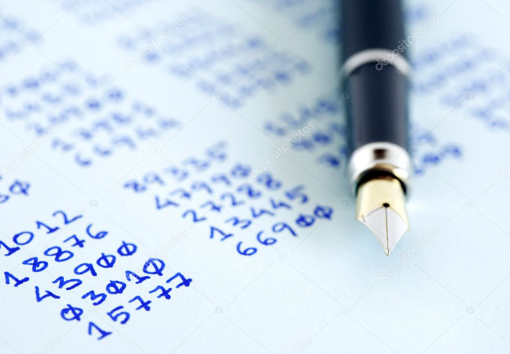 Closeup of fountain pen on paper with written numbers columns — Stock Photo #10729178