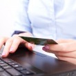 Business woman with credit card, typing — Stock Photo #10040978