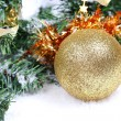 Christmas ball on firtree branch — Stock Photo
