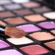 Makeup brush on make-up eye shadows — Stock Photo