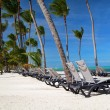 Chaise longues on caribbean beach — Stock Photo
