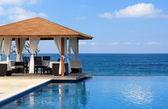 Pavilion and swimming pool near Atlantic Ocean — Stock Photo
