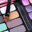 Professional make up brush on make-up eyeshadows set - Stock Photo