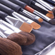 Set of make-up brushes in leather case - Stock Photo