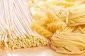 Tagliatelle, spirals and spaghetti — Stock Photo