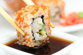 Sushi roll on white plate — Stock Photo