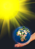 Earth model on a hand — Stock Photo