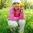 The little girl among dandelions — Stock Photo
