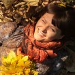 Stock Photo: Woman with autumn leaves