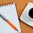 Notebook with pen and coffee on table top view. — Stock Photo