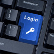 Stock Photo: Button keyboard with word login and key icon.