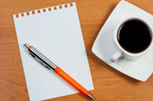 Worksheet with pen and coffee on table. — Stock Photo
