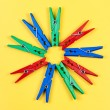 Pegs on yellow. — Stock Photo