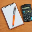 Notepad, calculator and pen on the table. — Stock Photo