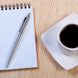 Notepad with pen and cup coffee. — Stock fotografie