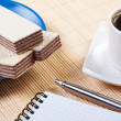 Cup coffee with waffles. Notepad and pen on table. — Stock Photo