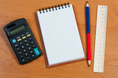 Notepad, calculator, and pencil on the table. — Stock Photo