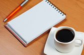 Notebook on table and coffee. — Stock Photo