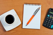 Coffee, notebook and pen on table. — Stock Photo
