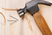 Hammer and nail on wooden boards. — Stock Photo