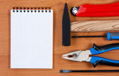 Notepad and tool top view. — Stock Photo