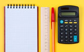 Notepad, calculator and wooden ruler with pen. — Stock Photo