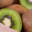 Kiwi fruit cut into pieces close-up. — Stock Photo