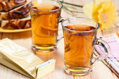 Tea in glass mugs. — Stock Photo