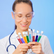 Medical test tubes with fluid sample closeup in doctor hand on b — Stock Photo #10355122