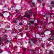 Many small ruby diamond stones, luxury background shallow depth - Stok fotoğraf
