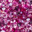 Many small ruby diamond stones, luxury background shallow depth - Stockfoto